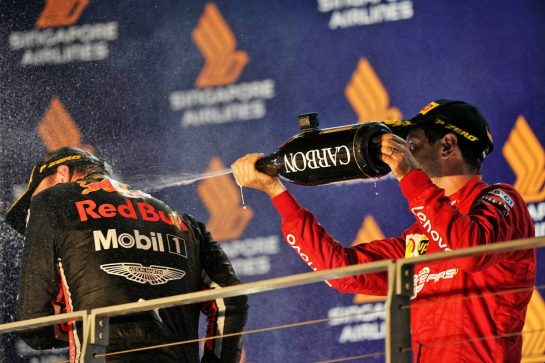 (L to R): Max Verstappen (NLD) Red Bull Racing celebrates his third position on the podium with second placed Charles Leclerc (MON) Ferrari. 22.09.2019. Formula 1 World Championship, Rd 15, Singapore Grand Prix, Marina Bay Street Circuit, Singapore, Race Day.  - www.xpbimages.com, EMail: requests@xpbimages.com - copy of publication required for printed pictures. Every used picture is fee-liable. © Copyright: Dungan / XPB Images