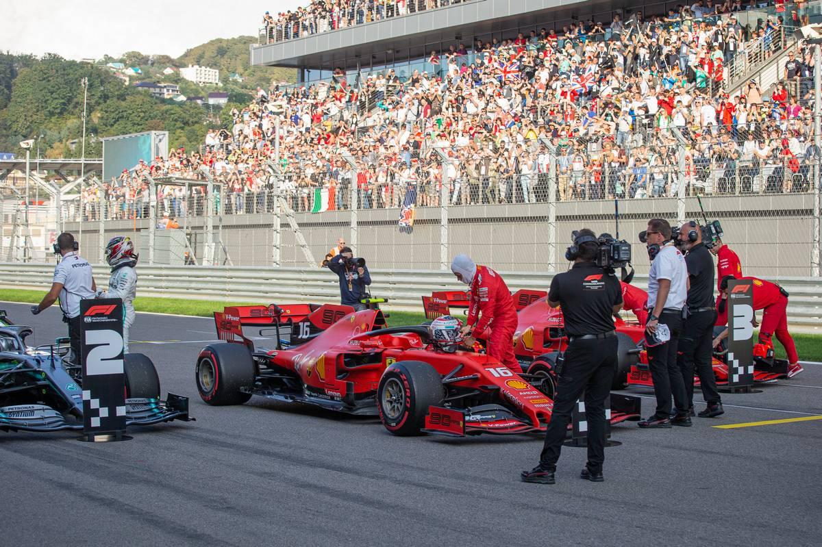 Lewis Hamilton (GBR) Mercedes AMG F1 W10 and Charles Leclerc (MON) Ferrari SF90 in qualifying parc ferme.