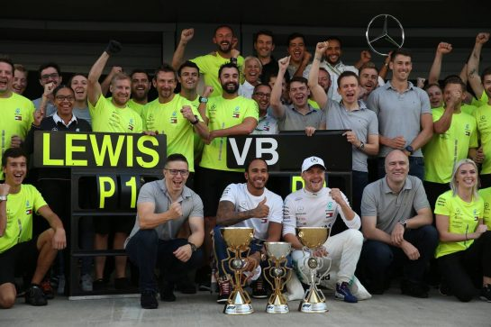 Lewis Hamilton (GBR) Mercedes AMG F1 W10 and Valtteri Bottas (FIN) Mercedes AMG F1 W10 celebrate with the team. 29.09.2019. Formula 1 World Championship, Rd 16, Russian Grand Prix, Sochi Autodrom, Sochi, Russia, Race Day. - www.xpbimages.com, EMail: requests@xpbimages.com - copy of publication required for printed pictures. Every used picture is fee-liable. © Copyright: Batchelor / XPB Images