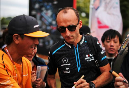 Robert Kubica (POL) Williams Racing signs autographs for the fans.