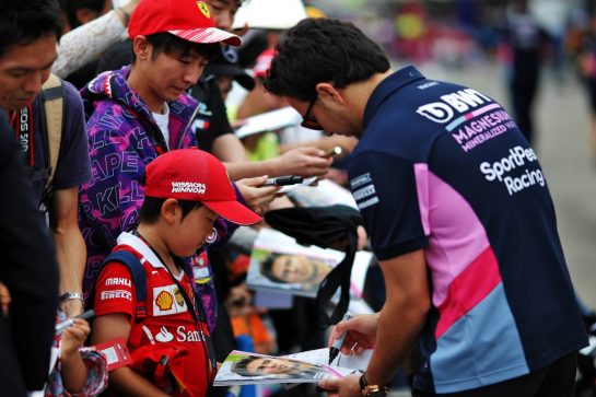 Sergio Perez (MEX) Racing Point F1 Team signs autographs for the fans.