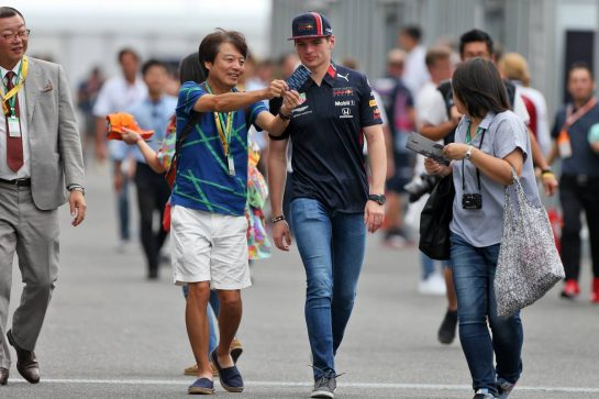 Max Verstappen (NLD) Red Bull Racing with fans.