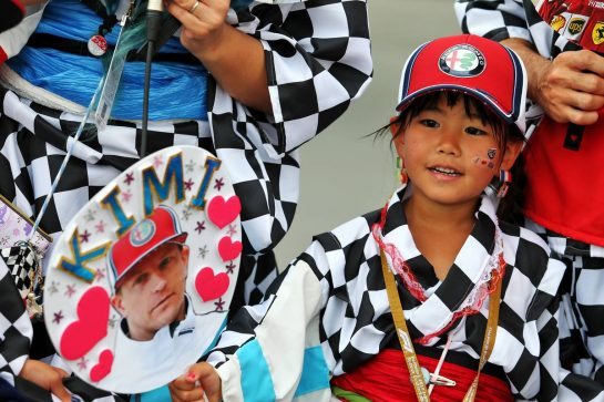 Circuit atmosphere - a young Kimi Raikkonen (FIN) Alfa Romeo Racing fan. 11.10.2019. Formula 1 World Championship, Rd 17, Japanese Grand Prix, Suzuka, Japan, Practice Day. - www.xpbimages.com, EMail: requests@xpbimages.com - copy of publication required for printed pictures. Every used picture is fee-liable. © Copyright: Moy / XPB Images