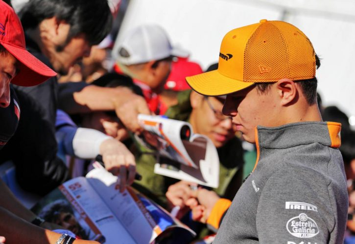 Lando Norris (GBR) McLaren signs autographs for the fans.