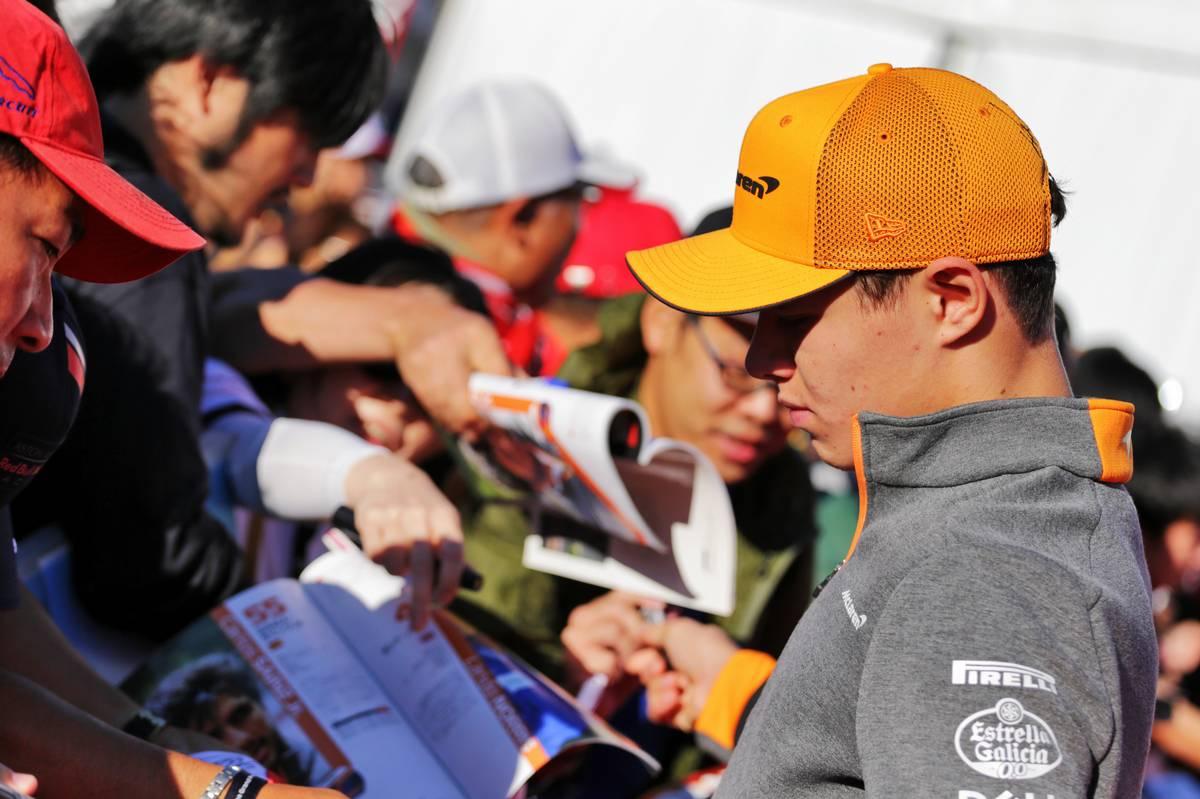 Lando Norris (GBR) McLaren signs autographs for the fans.