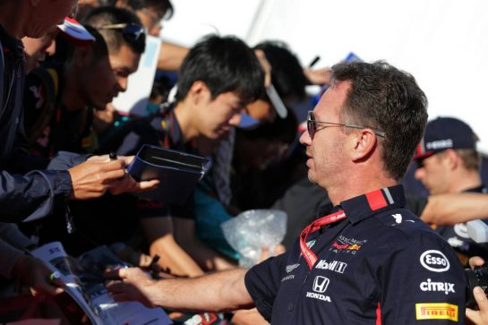 Christian Horner (GBR) Red Bull Racing Team Principal signs autographs for the fans.