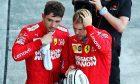 Charles Leclerc (MON) Ferrari with team mate Sebastian Vettel (GER) Ferrari in parc ferme