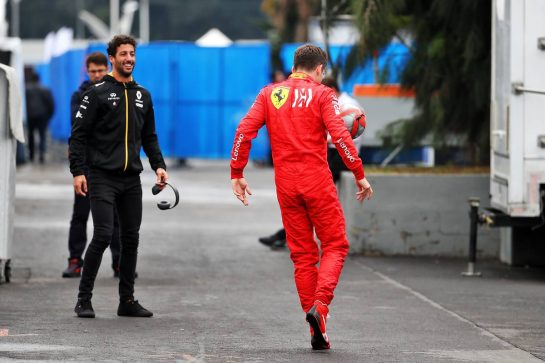 Charles Leclerc (MON) Ferrari and Daniel Ricciardo (AUS) Renault F1 Team play football in the paddock.