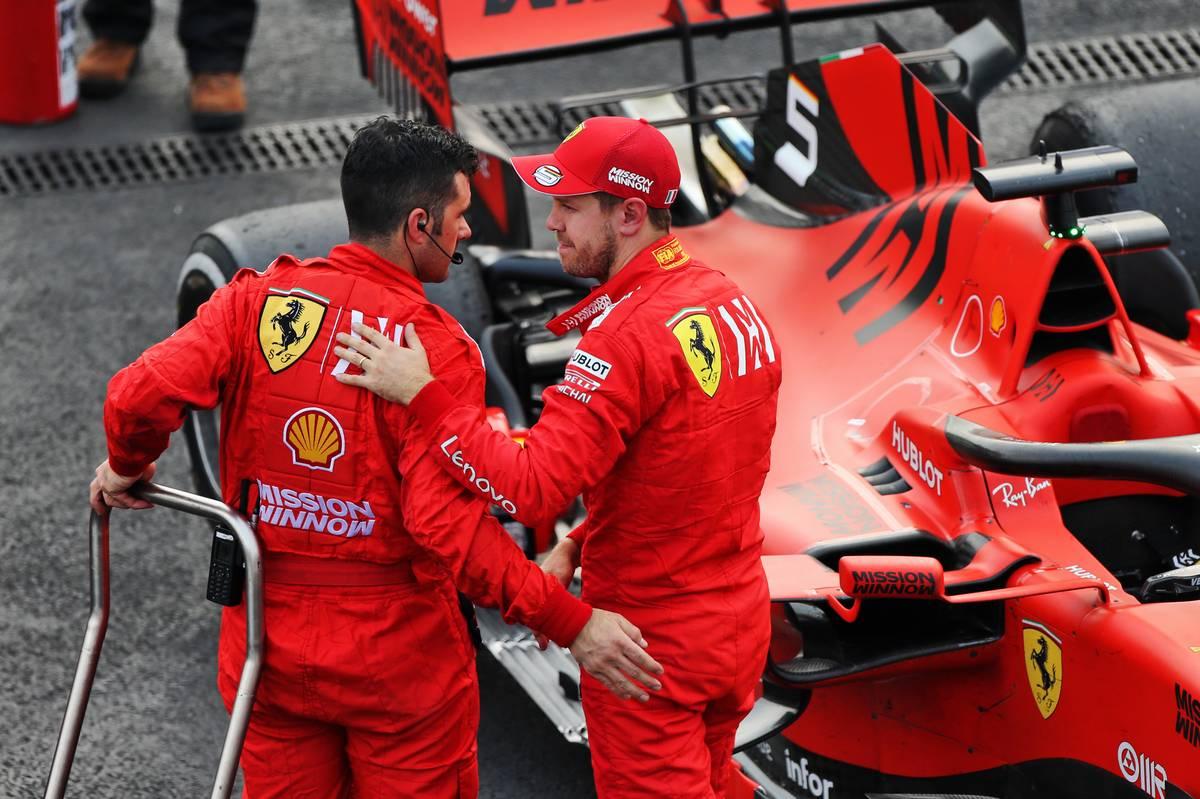 Sebastian Vettel (GER) Ferrari celebrates his second position in parc ferme.