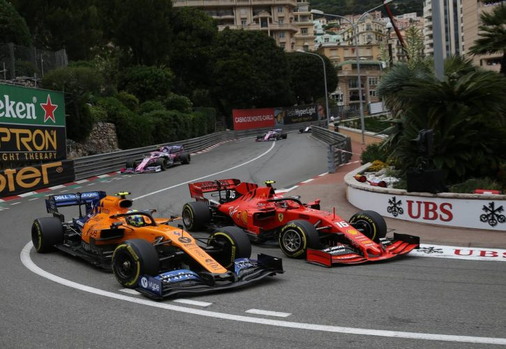 Lando Norris (GBR) McLaren MCL34 and Charles Leclerc (MON) Ferrari SF90.