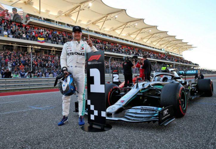 Valtteri Bottas (FIN) Mercedes AMG F1 W10 celebrates his pole position in qualifying parc ferme.