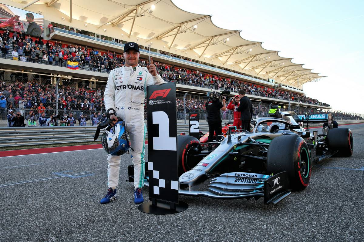 Valtteri Bottas (FIN) Mercedes AMG F1 W10 celebrates his pole position in qualifying parc ferme.