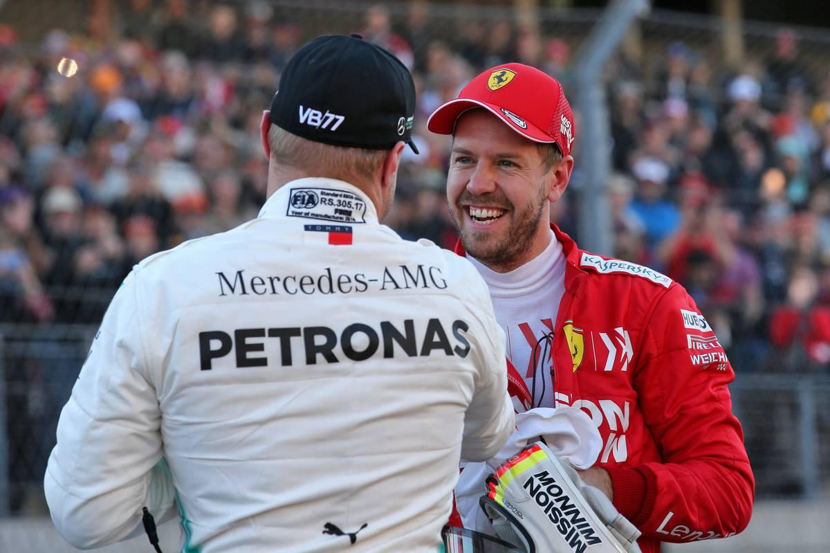 Valtteri Bottas (FIN) Mercedes AMG F1 celebrates his pole position in qualifying parc ferme with Sebastian Vettel (GER) Ferrari.