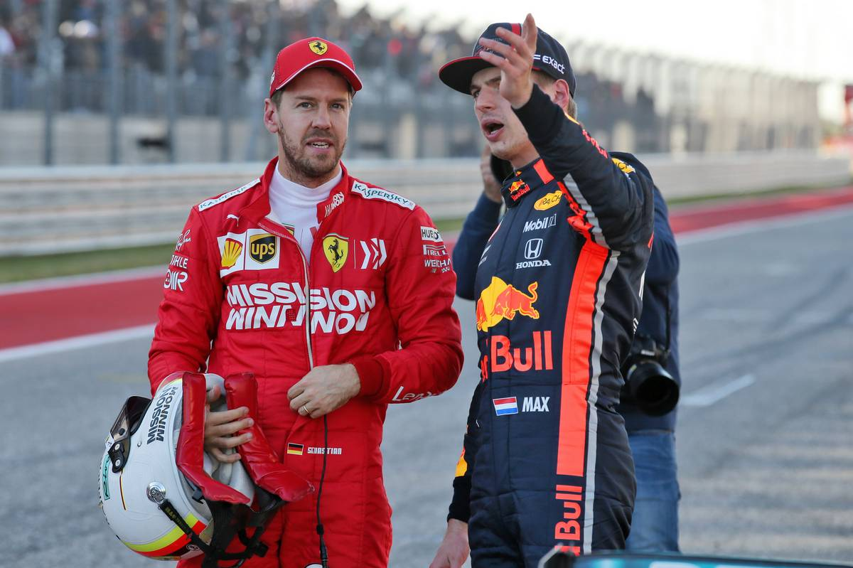 Sebastian Vettel (GER) Ferrari with Max Verstappen (NLD) Red Bull Racing in qualifying parc ferme.