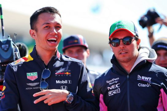 (L to R): Alexander Albon (THA) Red Bull Racing with Sergio Perez (MEX) Racing Point F1 Team on the drivers parade.