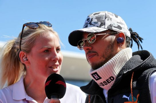 Lewis Hamilton (GBR) Mercedes AMG F1 with Rosanna Tennant (GBR) F1 Presenter on the drivers parade.