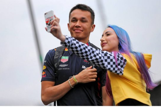 Alexander Albon (THA) Red Bull Racing with a fan.