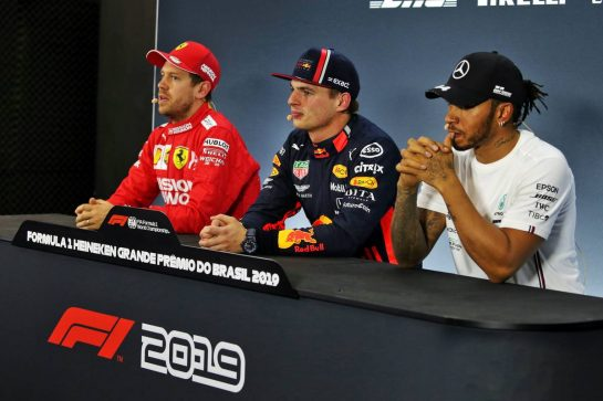 (L to R): Sebastian Vettel (GER) Ferrari; Max Verstappen (NLD) Red Bull Racing; and Lewis Hamilton (GBR) Mercedes AMG F1, in the post qualifying FIA Press Conference.