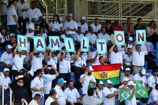 Circuit atmosphere - Lewis Hamilton (GBR) Mercedes AMG F1 fans in the grandstand.