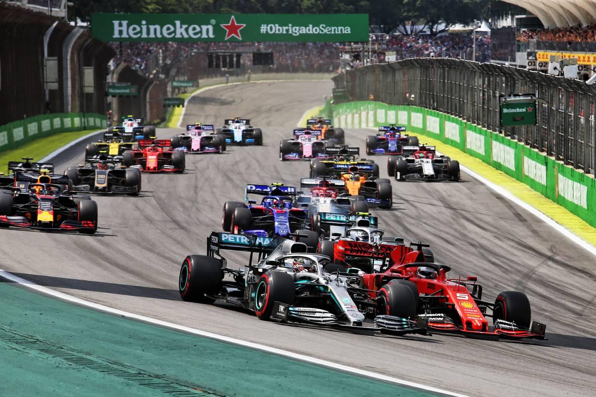 Lewis Hamilton (GBR) Mercedes AMG F1 W10 and Sebastian Vettel (GER) Ferrari SF90 at the start of the race.