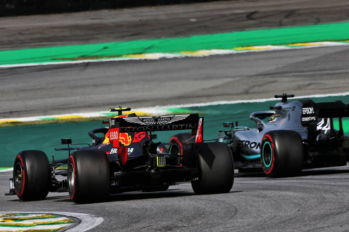 Alexander Albon (THA) Red Bull Racing RB15 and Lewis Hamilton (GBR) Mercedes AMG F1 W10 battle for position.