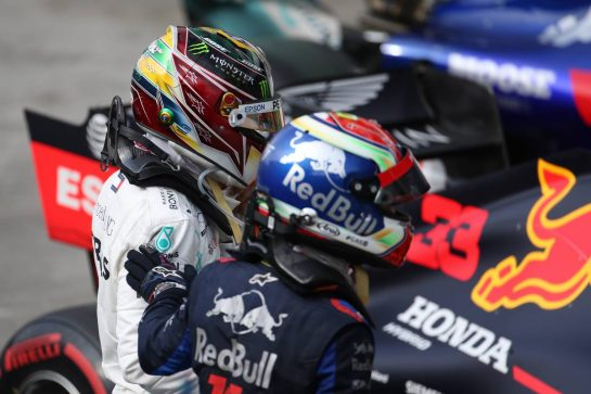 Lewis Hamilton (GBR) Mercedes AMG F1 W10 and 2nd place Pierre Gasly (FRA) Scuderia Toro Rosso STR14. 17.11.2019. Formula 1 World Championship, Rd 20, Brazilian Grand Prix, Sao Paulo, Brazil, Race Day. - www.xpbimages.com, EMail: requests@xpbimages.com © Copyright: Batchelor / XPB Images