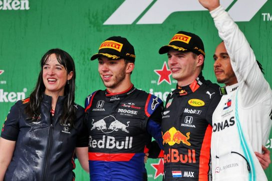 The podium (L to R): Hannah Schmitz (GBR) Red Bull Racing Senior Strategy Engineer; Pierre Gasly (FRA) Scuderia Toro Rosso, second; Max Verstappen (NLD) Red Bull Racing, race winner; Lewis Hamilton (GBR) Mercedes AMG F1, third.