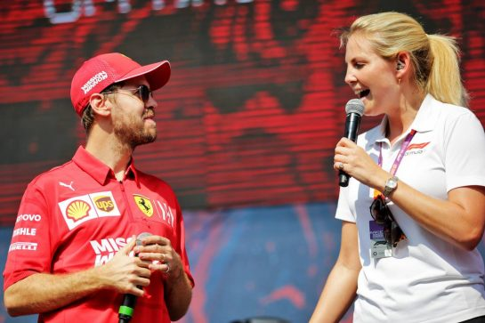 Sebastian Vettel (GER) Ferrari with Rosanna Tennant (GBR) F1 Presenter.