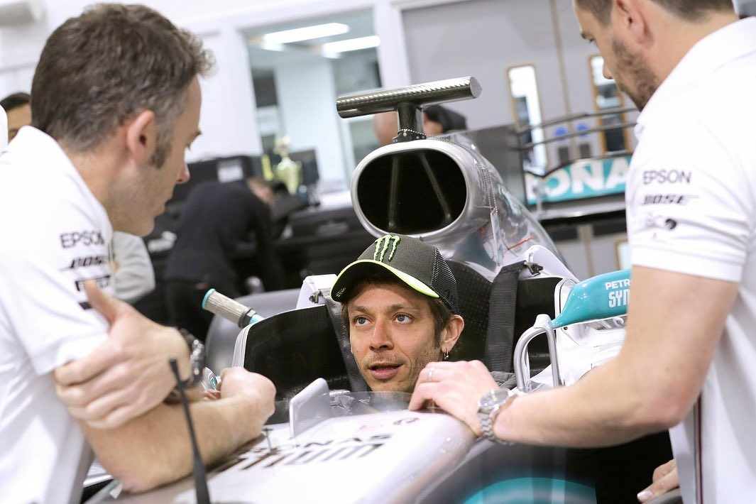 Lewis Hamilton and Valentino Rossi swap machines. Yes