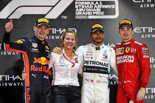 The podium (L to R): Max Verstappen (NLD) Red Bull Racing, second; Britta Seeger, Member of the Board of Management for Mercedes-Benz Cars Marketing and Sales; Lewis Hamilton (GBR) Mercedes AMG F1, race winner; Charles Leclerc (MON) Ferrari, third. 01.12.2019. Formula 1 World Championship, Rd 21, Abu Dhabi Grand Prix, Yas Marina Circuit, Abu Dhabi, Race Day. - www.xpbimages.com, EMail: requests@xpbimages.com © Copyright: Batchelor / XPB Images