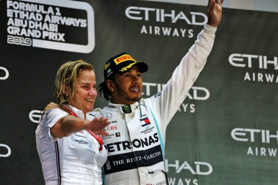 Race winner Lewis Hamilton (GBR) Mercedes AMG F1 celebrates on the podium with Britta Seeger, Member of the Board of Management for Mercedes-Benz Cars Marketing and Sales.