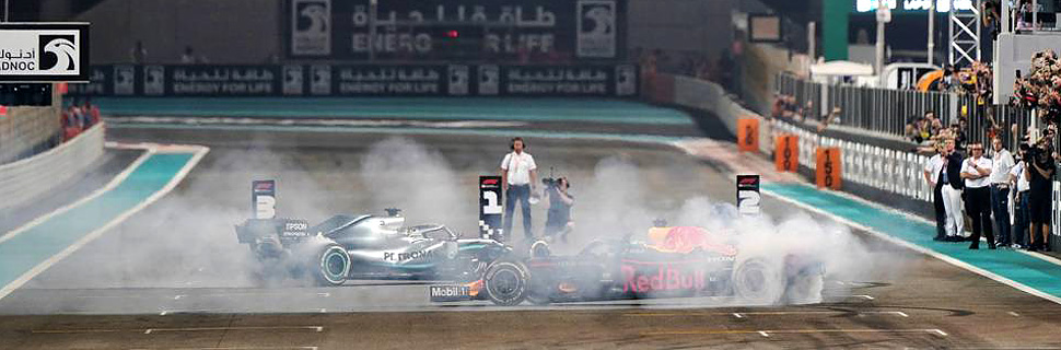Race winner Lewis Hamilton (GBR) Mercedes AMG F1 W10 and second placed Max Verstappen (NLD) Red Bull Racing RB15 celebrate at the end of the race.
