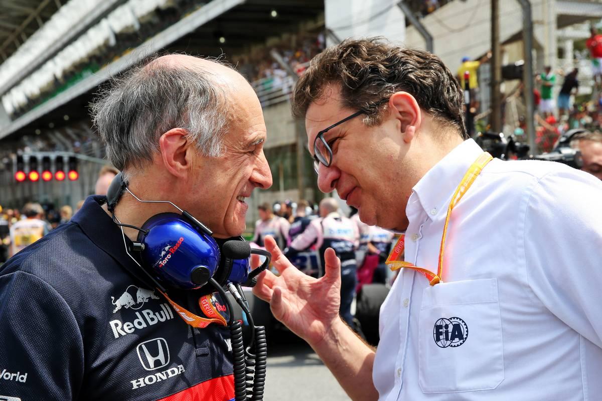 Franz Tost (AUT) Scuderia Toro Rosso Team Principal with Nicholas Tombazis (GRE) FIA Head of Single-Seater Technical Matters on the grid.