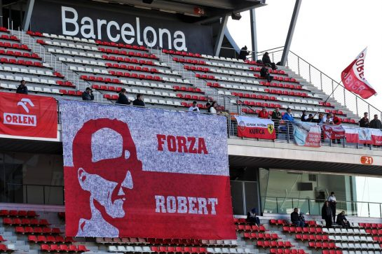 Banner for Robert Kubica (POL) Alfa Romeo Racing Reserve Driver with fans in the grandstand. 26.02.2020. Formula One Testing, Day One, Barcelona, Spain. Wednesday. - www.xpbimages.com, EMail: requests@xpbimages.com © Copyright: Batchelor / XPB Images