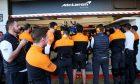 Human wall outside the McLaren pit garage.