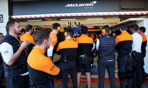Human wall outside the McLaren pit garage.