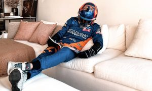 One driver's ready-to-race suited and booted confinement
