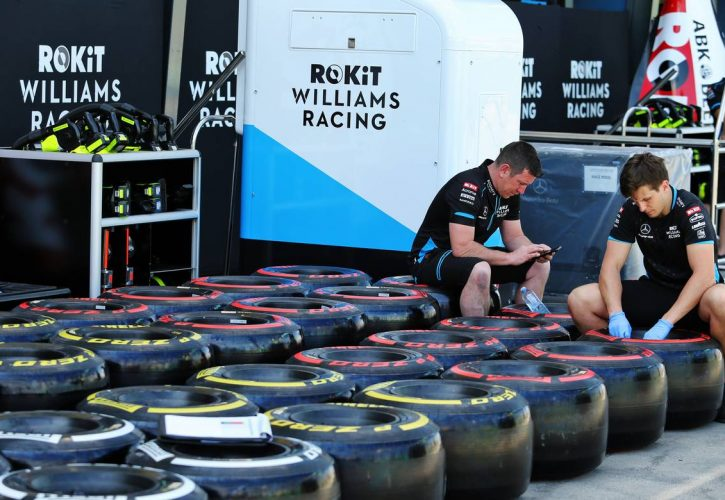 Pit atmosphere - Williams Racing mechanics with Pirelli tyres.