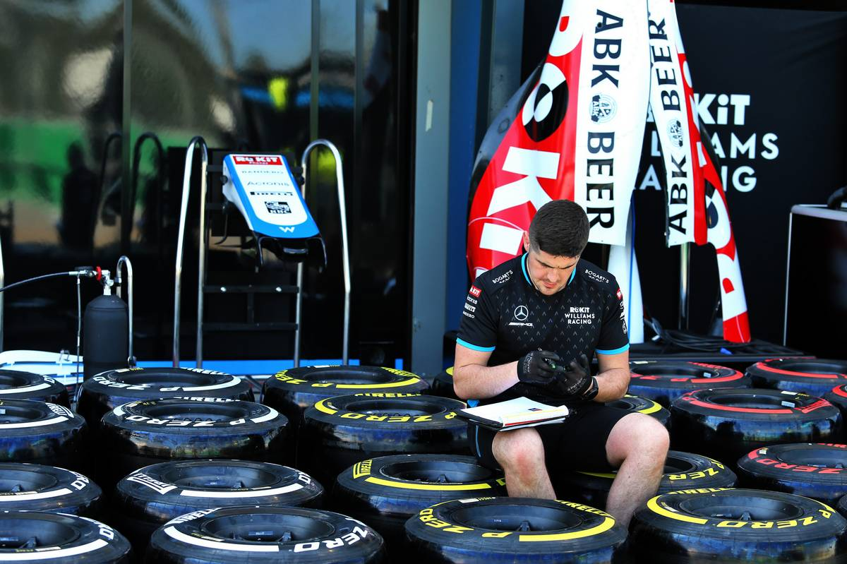 Pit atmosphere - Williams Racing mechanic with Pirelli tyres.