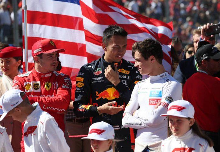 Charles Leclerc (MON) Ferrari SF90 with Alexander Albon (THA) Red Bull Racing RB15 and Lando Norris (GBR) McLaren MCL34.