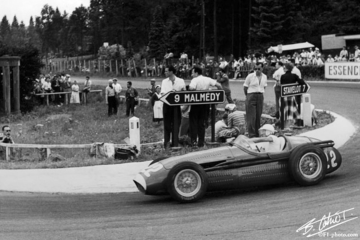 Stirling Moss racing in the 1954 Belgian Grand Prix at Circuit de Spa-Francorchamps.