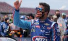 TALLADEGA, ALABAMA - JUNE 22: Bubba Wallace, driver of the #43 Victory Junction Chevrolet, gives a thumbs up prior to the NASCAR Cup Series GEICO 500 at Talladega Superspeedway on June 22, 2020 in Talladega, Alabama. A noose was found in the garage stall of NASCAR driver Bubba Wallace at Talladega Superspeedway a week after the organization banned the Confederate flag at its facilities.
