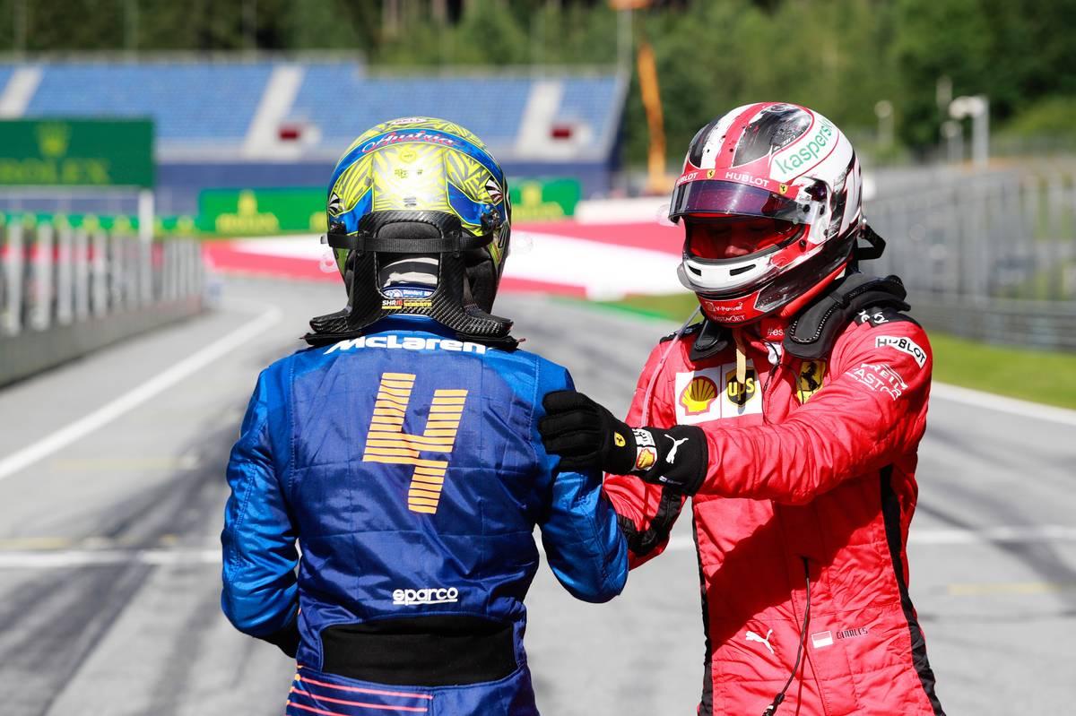 Third placed Lando Norris (GBR) McLaren celebrates with second placed Charles Leclerc (MON) Ferrari.
