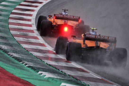 Carlos Sainz Jr (ESP) McLaren MCL35 leads team mate Lando Norris (GBR) McLaren MCL35. 11.07.2020. Formula 1 World Championship, Rd 2, Steiermark Grand Prix, Spielberg, Austria, Qualifying Day. - www.xpbimages.com, EMail: requests@xpbimages.com © Copyright: Charniaux / XPB Images