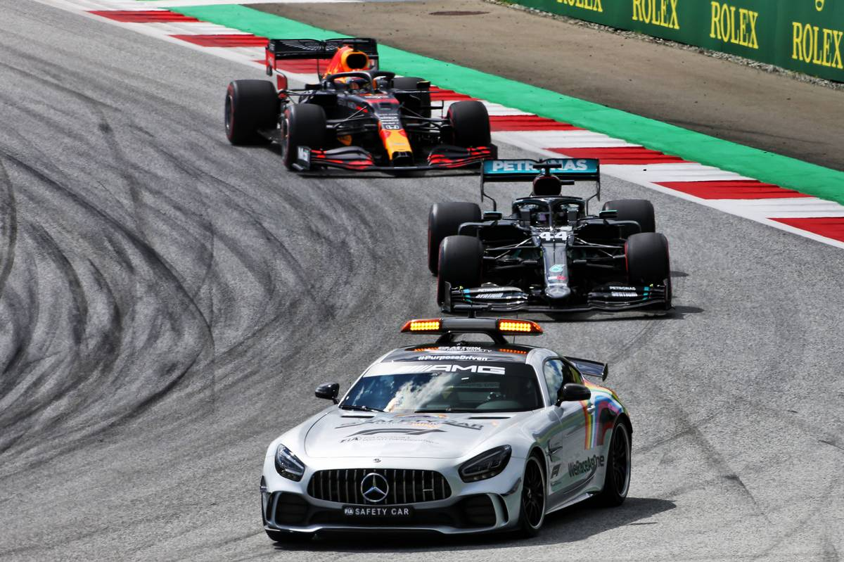 Lewis Hamilton (GBR) Mercedes AMG F1 W11 leads behind the FIA Safety Car.