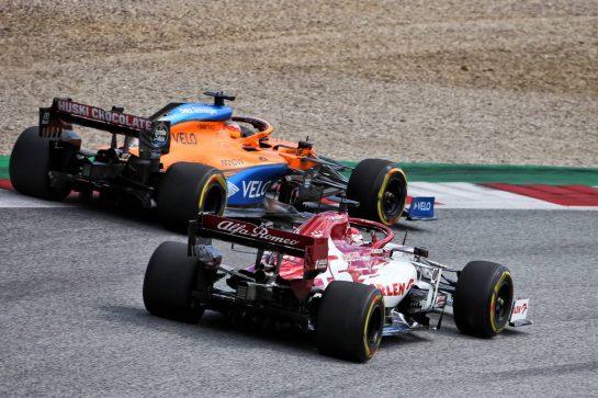 Carlos Sainz Jr (ESP) McLaren MCL35 and Kimi Raikkonen (FIN) Alfa Romeo Racing C39. 12.07.2020. Formula 1 World Championship, Rd 2, Steiermark Grand Prix, Spielberg, Austria, Race Day. - www.xpbimages.com, EMail: requests@xpbimages.com © Copyright: Charniaux / XPB Images