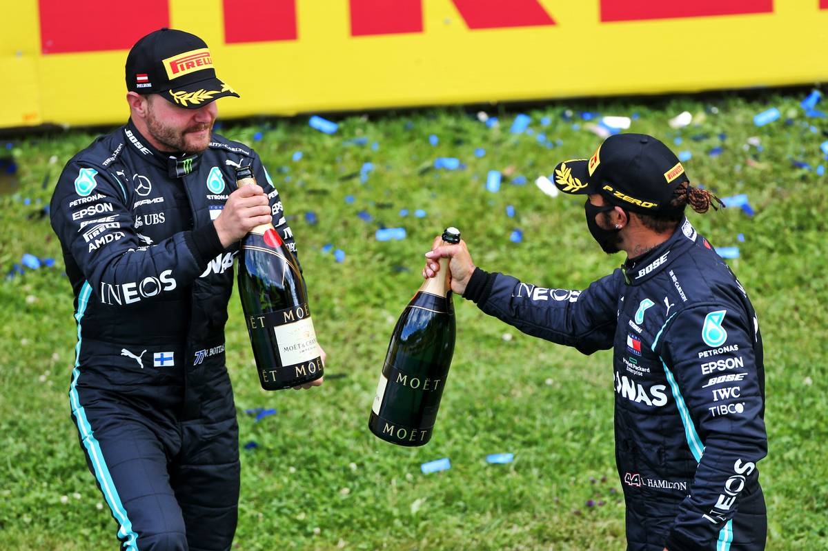 Valtteri Bottas (FIN) Mercedes AMG F1 celebrates his second position with race winner and team mate Lewis Hamilton (GBR) Mercedes AMG F1.