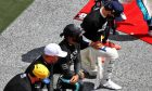 Lewis Hamilton (GBR) Mercedes AMG F1 takes a knee with team mate Valtteri Bottas (FIN) Mercedes AMG F1 on the grid.