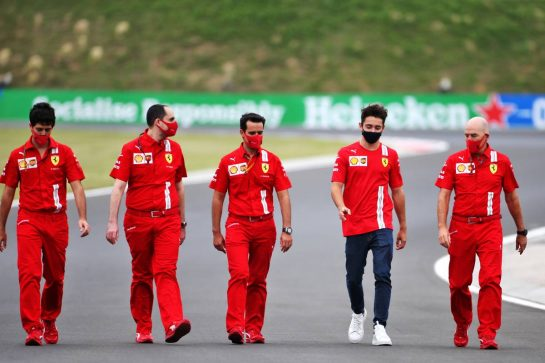 Charles Leclerc (MON) Ferrari walks the circuit with the team.