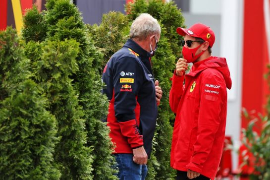 (L to R): Dr Helmut Marko (AUT) Red Bull Motorsport Consultant with Sebastian Vettel (GER) Ferrari.